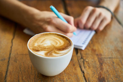 Contact coffee and notepad